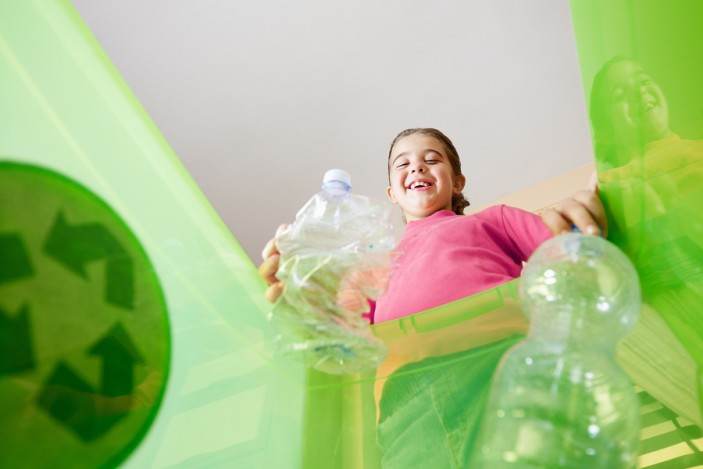 bigstock-Girl-Recycling-Plastic-Bottles-6134721-703x469